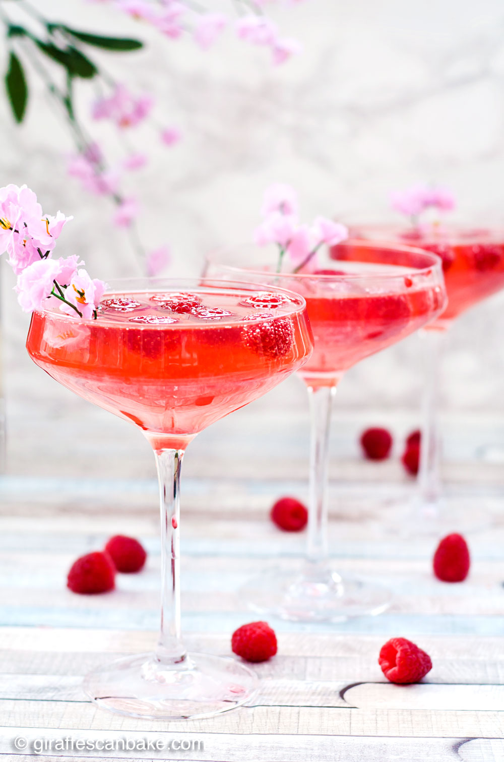 Raspberry Peach Champagne Cocktail